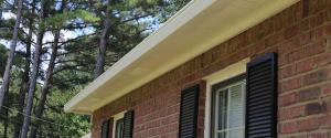 gutter guards on the outside of a brick home